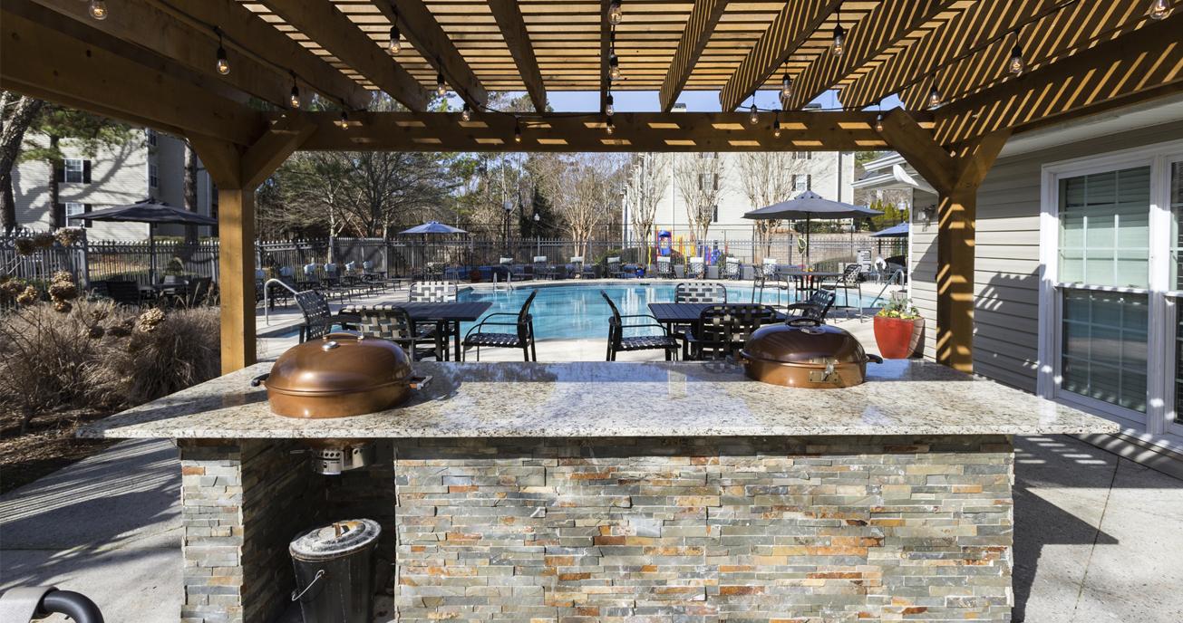 outdoor patio with grill and pool, river vista, atlanta ga