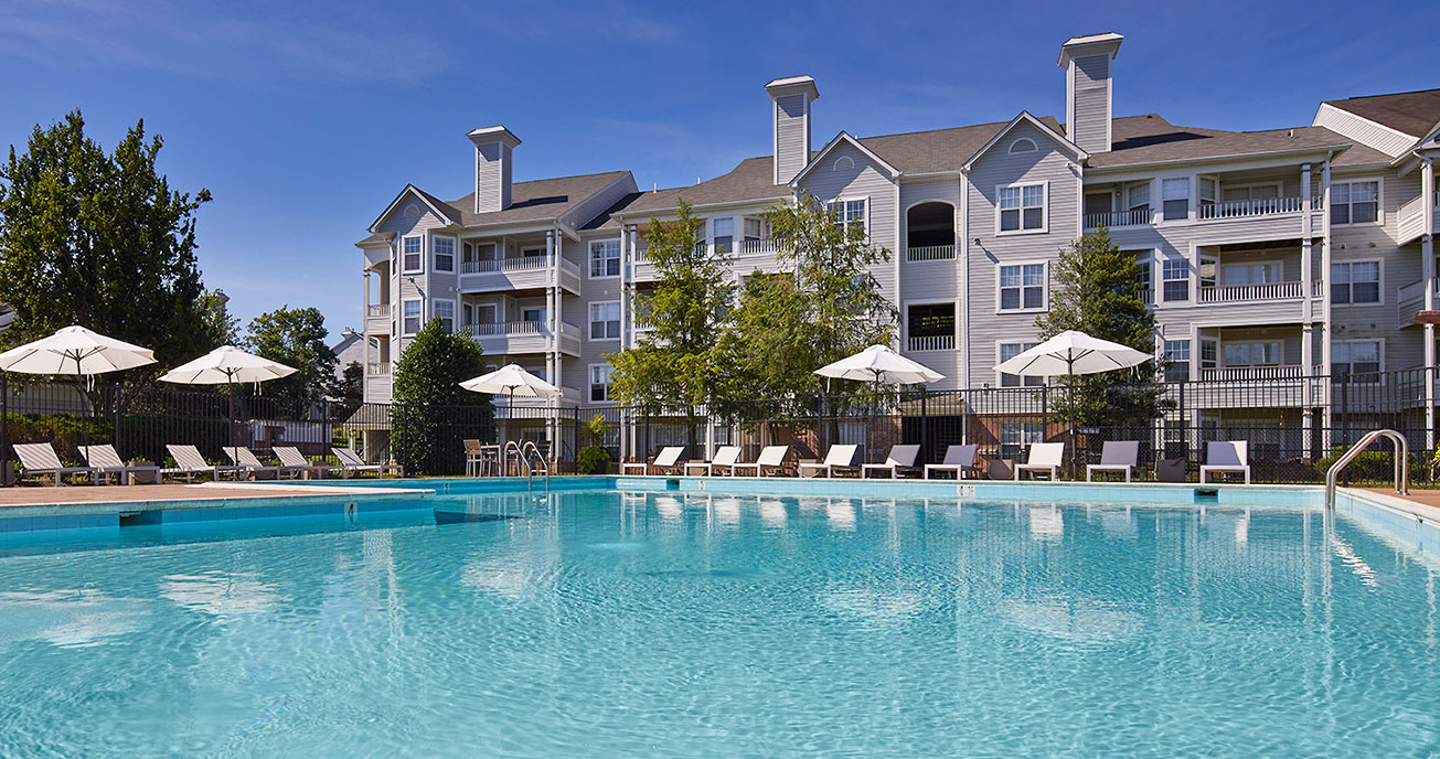 outdoor pool with apartment complex in background, seven oaks, odenton md